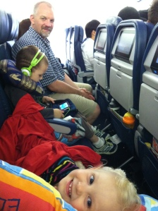 The family settling in for the thirteen hour flight to Michigan.